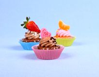 Appetizing cupcakes with kiss heart, tangerine, strawberry Royalty Free Stock Image