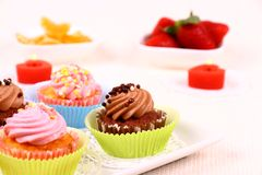 Appetizing cupcakes on white plate Stock Photo