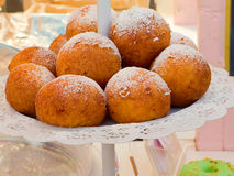 Appetizing delicious pastries and cakes at the fair. Royalty Free Stock Photo