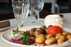 Appetizing dish with potatoes, mushrooms, tomato Royalty Free Stock Photography