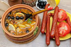 Appetizing dish of russian hodgepodge soup in ceramic pot Stock Image