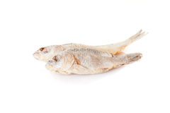 Appetizing dry and salted fish isolated at the white background Stock Images