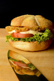 Appetizing fish burger with reflection on a knife Royalty Free Stock Photo