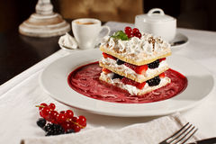 Appetizing french millefeuille dessert. Appetizing french millefeuilles raspberry, blackberry, strawberry dessert with coffee stock image
