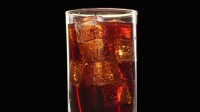 Appetizing fresh cola beverage with ice cubes and raising up air bubbles. 4k Dragon RED camera