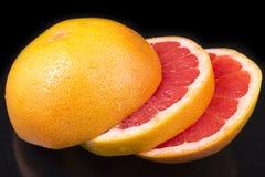 Appetizing fresh pieces of grapefruit Royalty Free Stock Photo