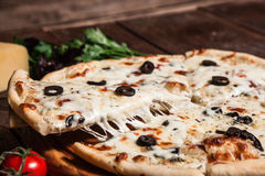 Appetizing fresh pizza on rustic table. Fast food. Pizza Fast Food Restaurant Menu Ingredients Italian Cuisine Food Concept Royalty Free Stock Images