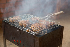 Appetizing fried skewers of chicken on the grill Royalty Free Stock Images