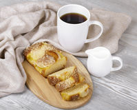 Appetizing fruitcake and coffee. Tasty fruitcake, fresh baking, coffee and cream Royalty Free Stock Image