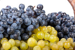 Appetizing grapes in a basket Royalty Free Stock Photos
