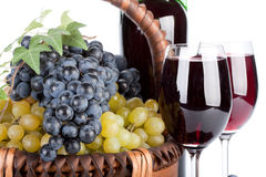Appetizing grapes in a basket Stock Image