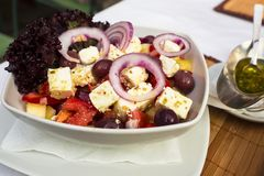 Appetizing Greek salad, Mediterranean cuisine Royalty Free Stock Image