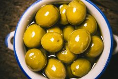Appetizing green salted olives i a rustic bowl Royalty Free Stock Photography