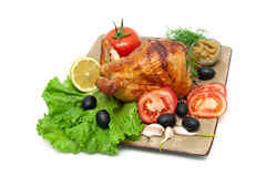 Appetizing grilled chicken with vegetables and herbs on a plate. Stock Photos