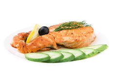 Appetizing Grilled Salmon with sliced cucumber. Lemon and black olives isolated over white Royalty Free Stock Photography