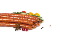 Appetizing grilled sausages with cherry tomatoes Stock Image