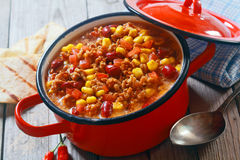 Appetizing Healthy Meaty Dish on Red Pot Stock Photo