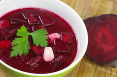 Appetizing hot beetroot soup Stock Images