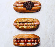 Appetizing hotdogs at white background Royalty Free Stock Photos
