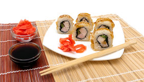 Appetizing Japanese rolls with eel on a plate Stock Photography