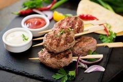 Appetizing kofta kebab (meatballs) with sauce Royalty Free Stock Images