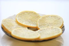 Appetizing lemon with slices and sugar, a teaspoon.  Stock Images