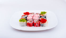 Appetizing made dish sushi. On the white plate Royalty Free Stock Photos