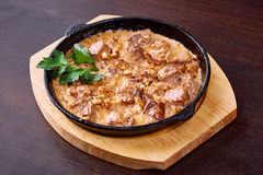 Appetizing meat baked with cheese and walnuts Royalty Free Stock Photo