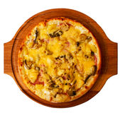 Appetizing mushrooms pizza cheese on wooden tray Royalty Free Stock Photography