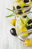 Appetizing olive oil with olives Stock Photos