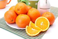 Appetizing oranges on plate Royalty Free Stock Images