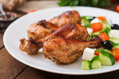 Appetizing oven baked golden chicken drumsticks Royalty Free Stock Photos