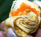 Appetizing pancake with red caviar Stock Photography