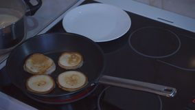Appetizing pancakes are cooked in frying pan stock video