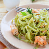 Appetizing pasta with spinach salmon Stock Image