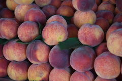 Appetizing peaches on a counter of shop Royalty Free Stock Photography