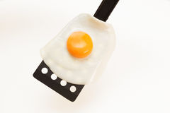 Appetizing and Perfectly Fried Egg on a Spatula, isolated on white background Royalty Free Stock Image
