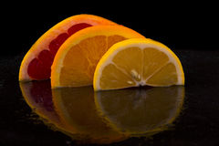 Appetizing piece of fresh grapefruit, lemon and orange Stock Image