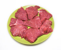 Appetizing pieces of beef on green plate Royalty Free Stock Photos