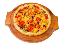 Appetizing pizza with cheese on wooden tray close Stock Image