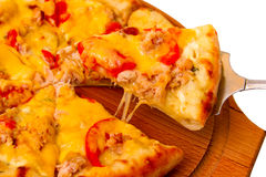 Appetizing pizza cheese wooden tray closeup on Stock Photo