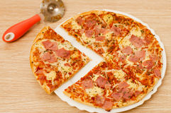 Appetizing pizza with ham Stock Photos