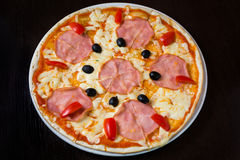 Appetizing pizza with ham Royalty Free Stock Image