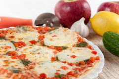 Appetizing pizza with mozzarella cheese Royalty Free Stock Photos