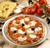 Appetizing pizza mozzarella and fresh tomatoes Stock Photo