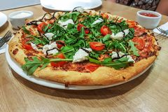 Appetizing pizza in the restaurant Stock Photo