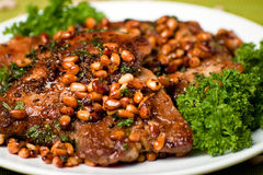 Appetizing pork chop with cedar nutlets Royalty Free Stock Images