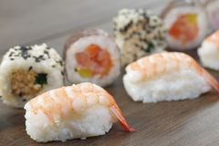 Appetizing  portion sushi. Portion sushi and wooden hopsticks on plate Royalty Free Stock Photo