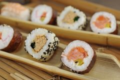 Appetizing  portion sushi. Portion sushi and wooden hopsticks on plate Stock Images