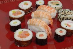Appetizing  portion sushi. Portion sushi and wooden hopsticks on plate Stock Photography